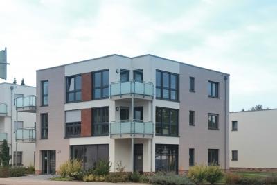 Neubau eines Kindergartens, eines Wohngebäudes und eines Wohn- und Geschäftshauses mit gemeinsamer Tiefgarage